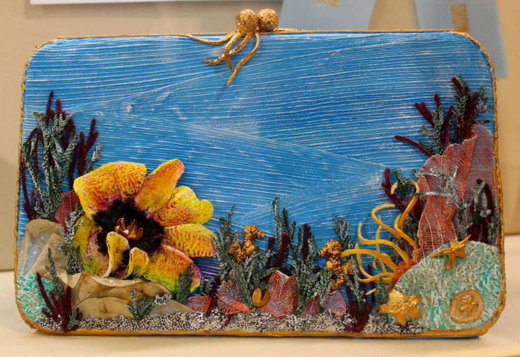 a detailed family guide to the Philadelphia flower show turquoise clutch